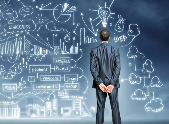 a man looking at a wall of connected ideas